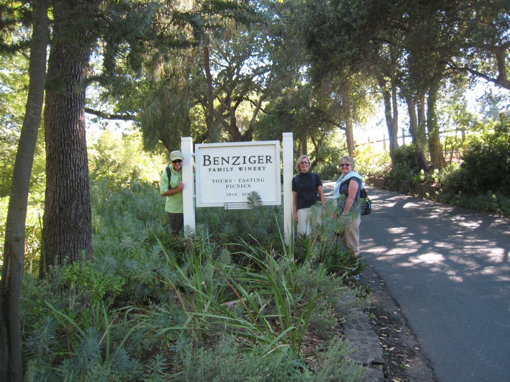 Hikers pose with sign for Benzinger Family Winery