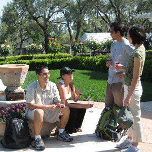 Group of people taste wine surrounding fountain